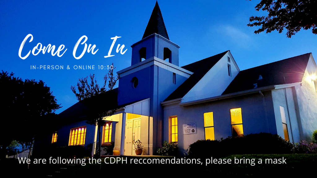 """Picture of Hillcrest Building lit up at night, with text that reads """"Come on In, In person or online 10:30"""" and """"we are following the CDPH guidelines, please bring a mask"""""""